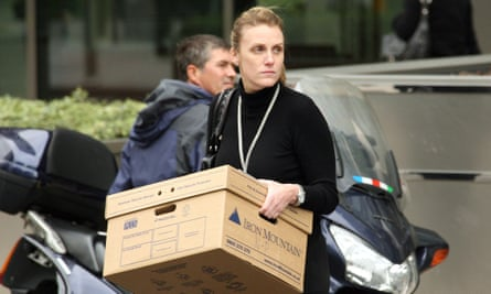 A Lehman Brothers employee leaving the Canary Wharf building after the bank filed for bankruptcyin 2008