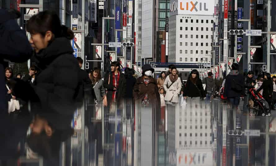 Shoppers in Tokyo's Ginza district. The government needs consumers to spend more to boost the economy.