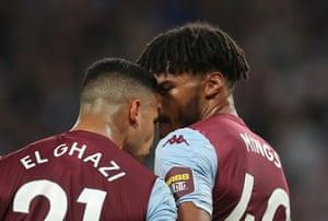Aston Villa's Anwar El Ghazi and Tyrone Mings clash.