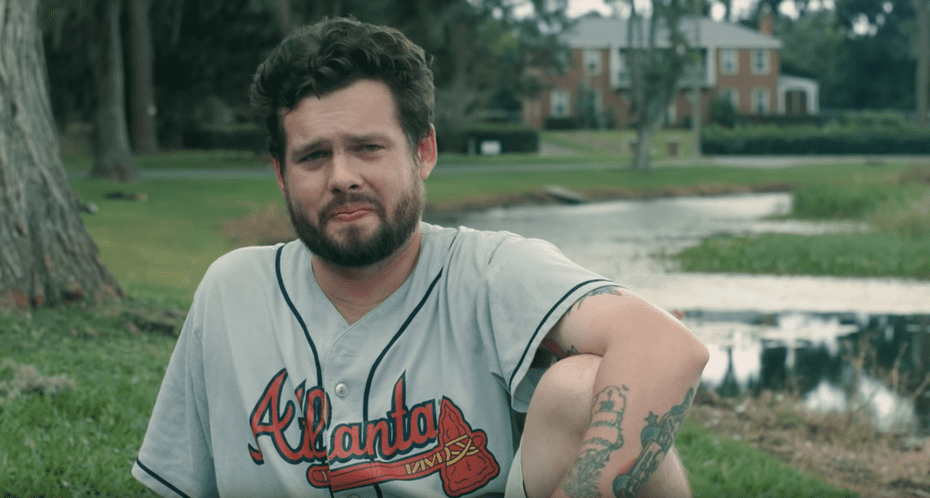 Tyler Flanigan sitting in a park