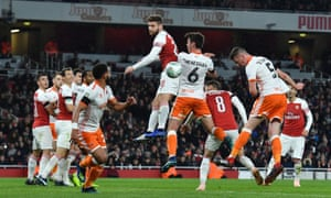Paudie O'Connor heads Blackpool back into the game.