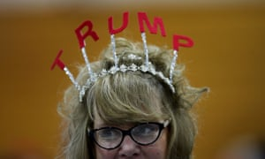 A Donald Trump supporter wears in tiara with TRUMP letters on top