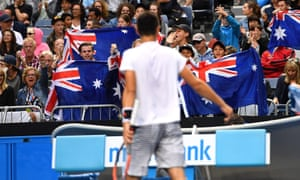 Tomic fans encourage their man.