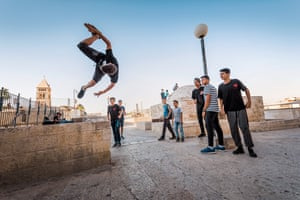 Teenagers do parkour on the Galizia roofs
