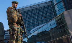 A Belgian soldier patrols outside the European commission headquarters