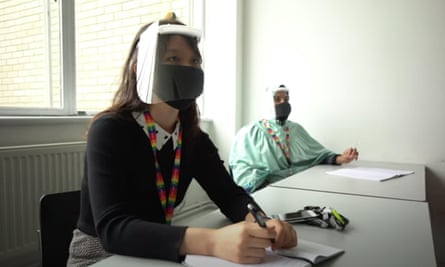 A still from a Bristol university promotional video, showing a student wearing a face masks and a visor to protect from coronavirus.