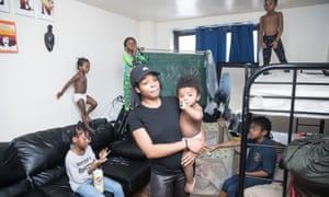 Areletha McLain with her children in a temporary apartment in New York City. She is currently fighting to keep her home.