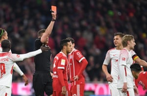 Willi Orban, right, is shown a red card.