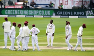 West Indies players appear dejected after an unsuccessful review for LBW against England's Dom Sibley.
