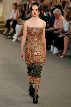 A model in a sequinned bustier dress.