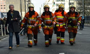 Firefighters arrive at the scene near Maelbeek metro station