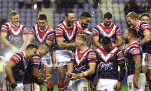 Sydney Roosters' Boyd Cordner (centre left) and team-mates celebrate with the trophy after winning the World Club Challenge.