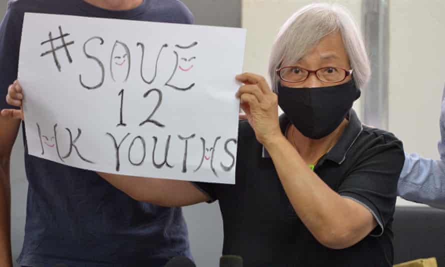 Pro-democracy protester Alexandra Wong – also known as 'Grandma Wong' holds up a placard to highlight the plight of 12 Hong Kong youths jailed on the mainland after allegedly trying to flee the territory by boat for Taiwan.