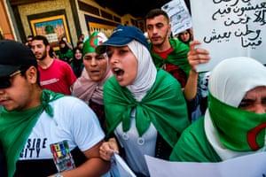 Students draped in national flags take part in a demonstration in Algiers, Algeria