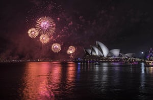 The midnight fireworks light up the Sydney Opera House