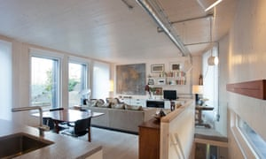 Feel the warmth: the open-plan kitchen and sitting room with large windows on to the garden.