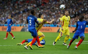 Romania's Nicolae Stanciu is clearly tripped by Evra.