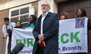 Jeremy Corbyn is joined by porters and cleaning staff during a speech outside Soas University of London.