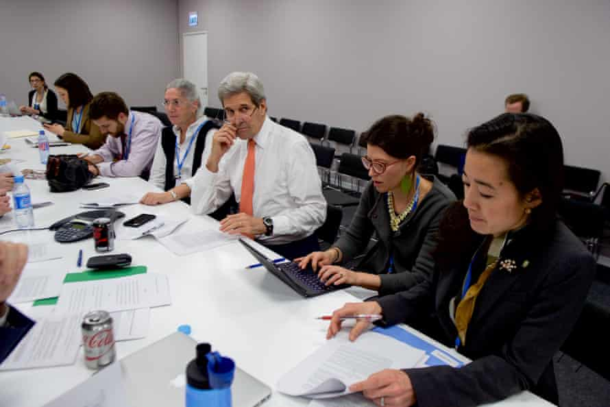 Secretary Kerry and a team of advisers discuss the final draft language of the agreement.