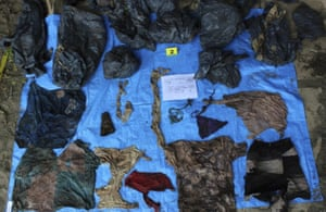 Clothing items found at the site of a clandestine burial pit in the Gulf coast state of Veracruz, Mexico. Veracruz state prosecutor Jorge Winckler said the bodies were buried at least two years ago and did not rule out finding more remains.