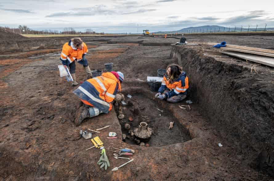 Archaeologists at the grave