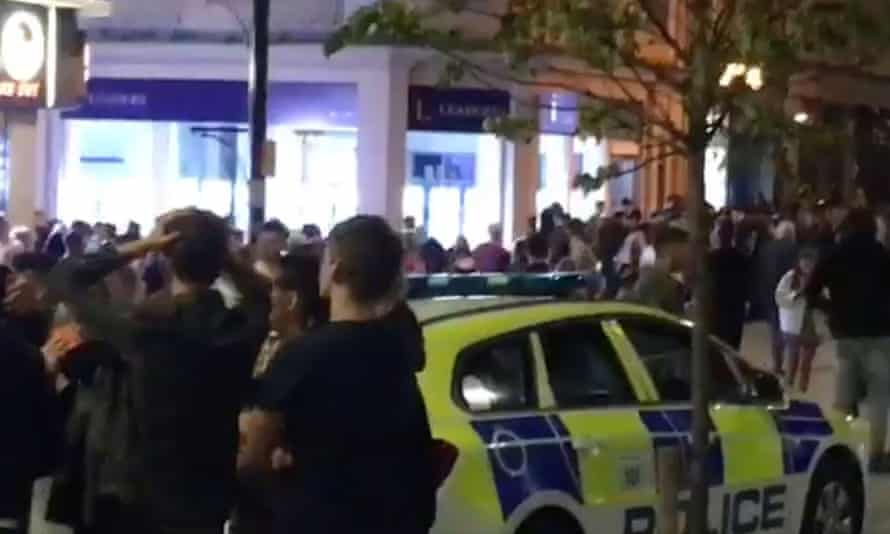 People outside an evacuated nightclub in Bournemouth