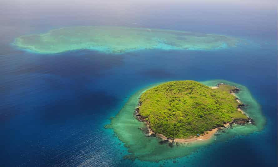Uninhabited island with coral reef, near Grande Terre island, Mayotte.