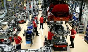 Employees of German car manufacturer Porsche assembling sports cars at the Porsche factory in Stuttgart-Zuffenhausen, Germany.
