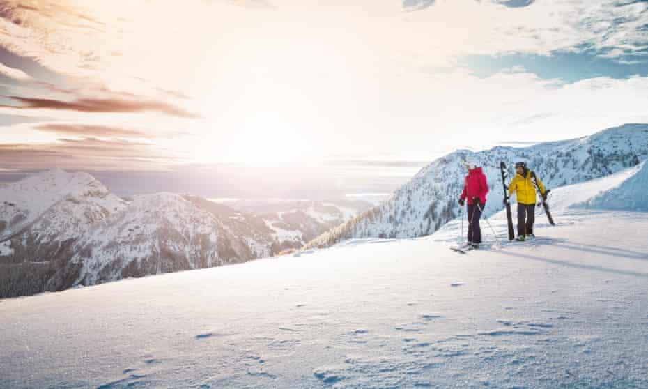 Two skiers on the slopes at Kitzbühel, Austria.
