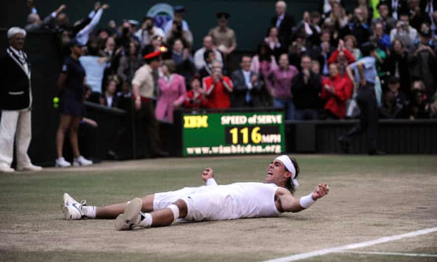 Rafael Nadal falls to the ground after claiming victory.