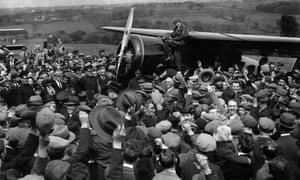 EARHARTFILE--A crowd cheers for Amelia Earhart, the first woman to fly across the Atlantic alone, as she boards her single-engine Lockheed Vega airplane in Londonderry, Northern Ireland, for the trip to London May 22, 1932. Earhart vanished mysteriously over the Pacific during her attempted round-the-world flight in 1937. (AP Photo/File)
