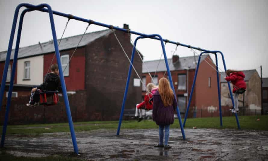 Children play in a park in Gorton near Manchester