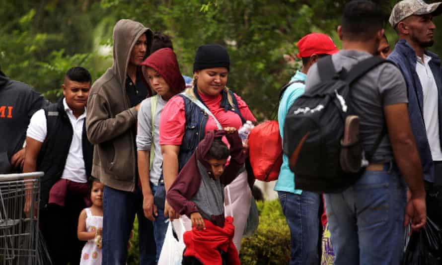 Honduran migrant Denia Carranza, 24, and her son Robert, 7, leave Casa del Migrante migrant shelter to board a bus, in Ciudad Juarez.