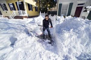 Maok Niebaur, 25, shovels snow for an elderly neighbour in Virginia