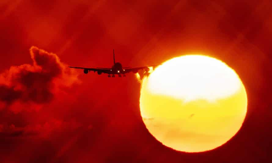 An aircraft passes the sun as the annual average global temperature is expected to increase.