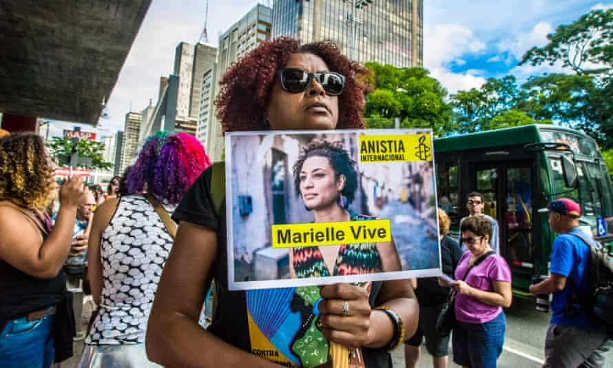 People gather in São Paulo, Brazil on 14 April 2018 to mark Marielle Franco's murder. Her killing remains unsolved.