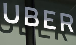 "FILES-US-INTERNET-TRANSPORT-UBER(FILES) In this file photo taken on May 08, 2018, the Uber logo is seen at the second annual Uber Elevate Summit at the Skirball Center in Los Angeles, California. - Uber chief Dara Khosrowshahi said on Wednesday, August 5, 2018 the smartphone-summoned ride service is reinforcing safeguards for passengers and their personal information. Features to be added to the app in the coming months include ""Ride Check,"" which uses location tracking already built into the service to detect when cars have stopped unexpectedly. If a crash is suspected, the driver and passenger will receive a prompt on their phones to order a courtesy ride or use the in-app emergency call button introduced earlier this year. (Photo by Robyn Beck / AFP)ROBYN BECK/AFP/Getty Images"