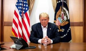 Donald Trump poses in his conference room at at Walter Reed Military Medical Center in an image released on Sunday night. Mary Trump said the family sees illness as 'weakness'.