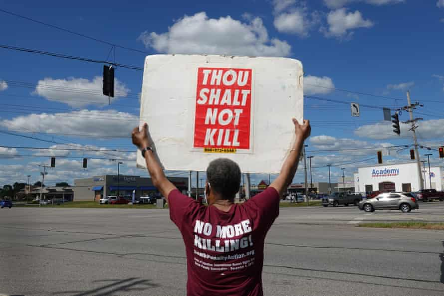 A protester holds up a sign near the Federal Correctional Complex in Terre Haute, Indiana.