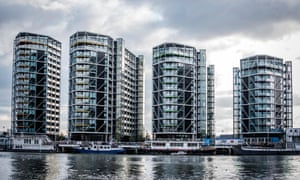 New buildings and houseboats on River Thames, London.