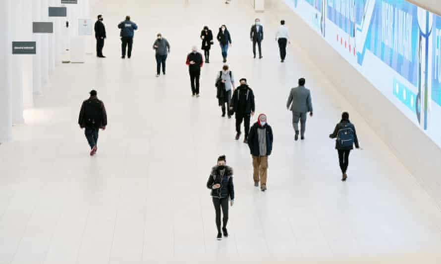 "Commuters wear masks while walking through the World Trade Center's transportation hub, Tuesday, Nov. 17, 2020 in New York. The Metropolitan Transportation Authority, in conjunction with regional rail lines, announced at a news conference a ""Mask Force"" that encourages universal mask usage on public transit. (AP Photo/Mark Lennihan)"