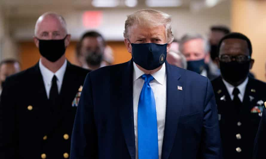 Trump at Walter Reed medical center at the weekend. More than 135,000 Americans have died from coronavirus.