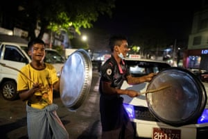 People bang pots and pans during the protest