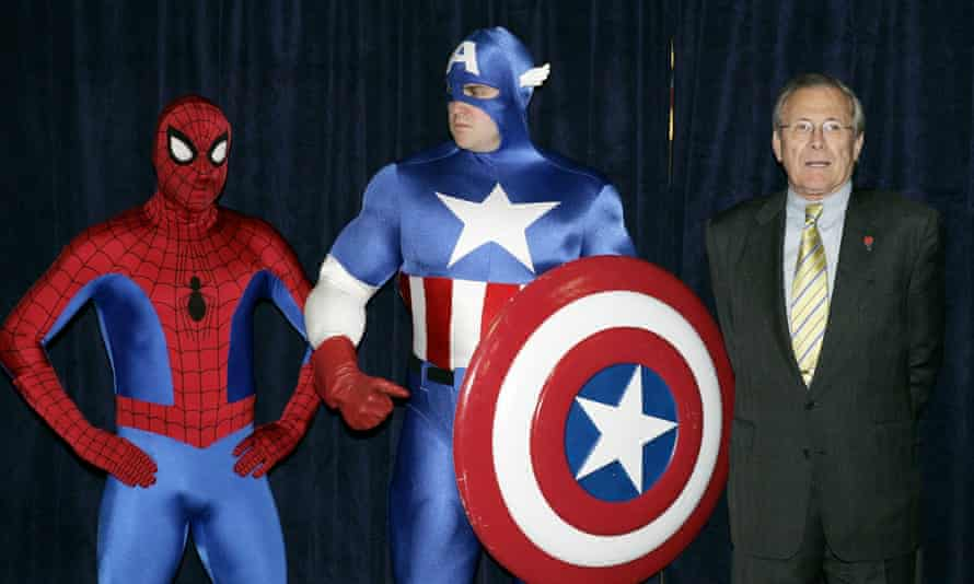 US secretary of defence Donald Rumsfeld stands alongside Spiderman and Captain America at the Pentagon during the promotion of a special military-themed custom comic.
