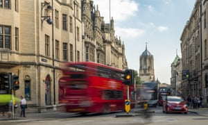 A bus crosses Carfax, a busy road junction in Oxford.