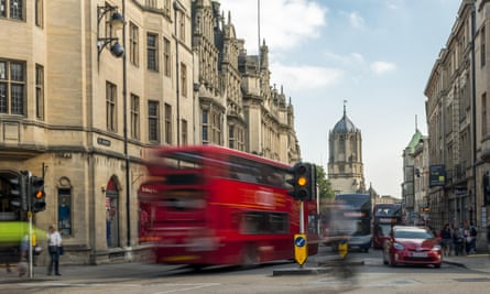 A bus crosses Carfax, a busy road junction where St Aldate's, Cornmarket Street, Queen Street and the High Street in Oxford meet
