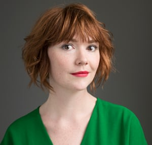 Elf Lyons wearing a green dress