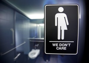 A sign protesting a recent law restricting transgender bathroom access.
