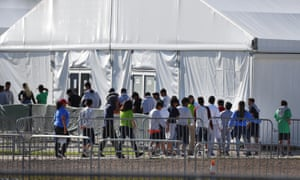 Children line up to enter a tent at the Homestead facility in Florida.