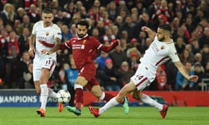 Aleksandar Kolarov (left) and Kostas Manolas try to keep Liverpool's Mohamed Salah in check during Roma's crushing first leg defeat in the Champions League semi-final.